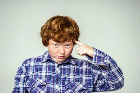 laughable: Emotional portrait of red-haired boy, attractive for advertising Stock Photo
