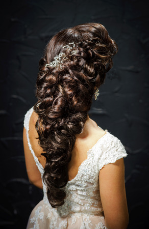hairstyles: Beautiful bride with fashion wedding hair-style, studio portrait