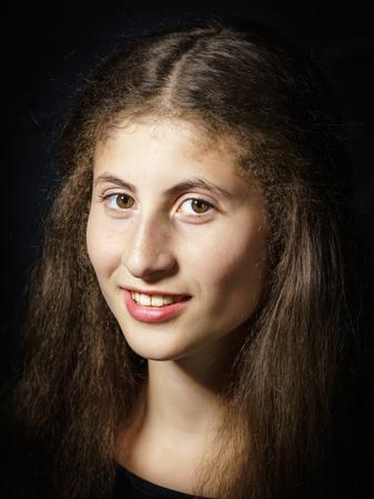 mona lisa: Cute young armenian girl posing in studio like Mona Lisa Stock Photo