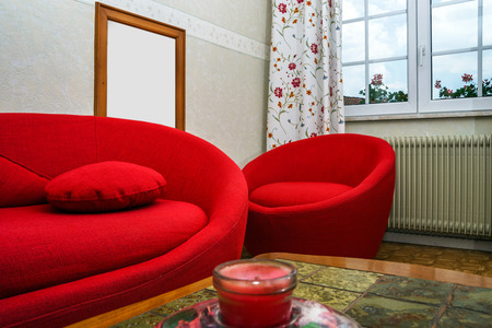 red sofa: Red round sofa in countryside renovated house