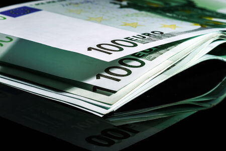 european union currency: 100 euro banknotes in a row. European Union Currency Stock Photo