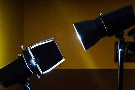 duelling: Duel of two professional photo flash lamps in studio