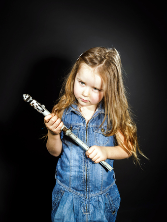 alligator wrench: Cute little girl with gas spanner in her hands ready to professional constructing work Stock Photo