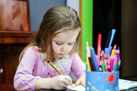 letter word: Cute little girl studing to speaking and writing letters at home lesson with her mother Stock Photo