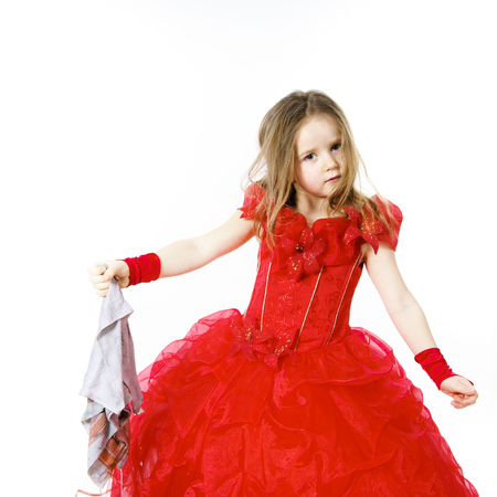 beautiful cinderella: Young cinderella dressed in red preparing to mop the floor by dirty cloth. Contrast things concept. Stock Photo