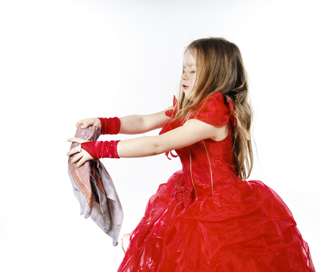 floor cloth: Young cinderella dressed in red preparing to mop the floor by dirty cloth. Contrast things concept. Stock Photo