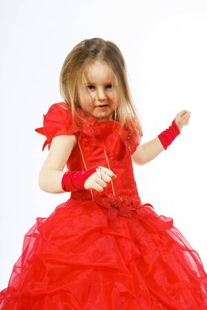 fandango: Cute little princess dressed in red dancing. Isolated on white background. Children fashion.