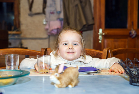 a little dinner: Funny little girl waiting for dinner, countryside house
