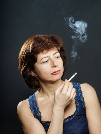 robustness: Young woman smoking cigarette, healthcare concept, isolated