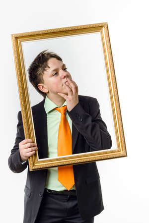 emphatic: Expressive teenage boy posing with picture frame, isolated on white