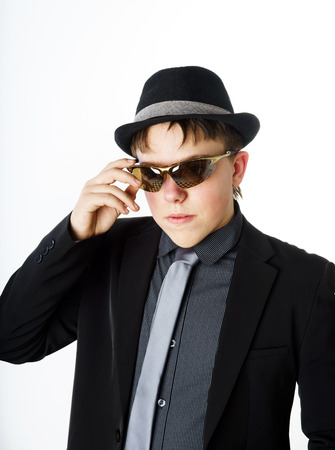 emphatic: Expressive teenage boy dressed in suit isolated on white background