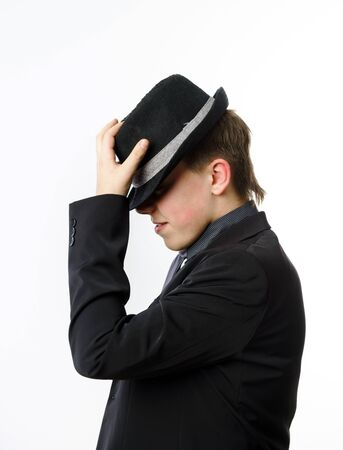 expressive: Expressive teenage boy dressed in suit isolated on white background