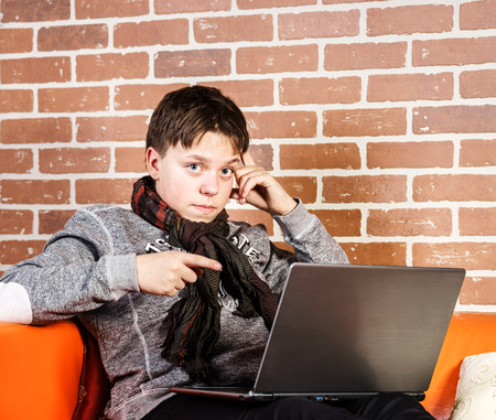 composure: Teenage boy working on laptop. Concentration and composure. Success concept. Stock Photo