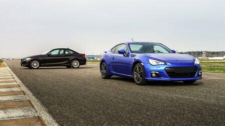 Two sport car comperison on race way track Standard-Bild