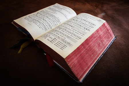 Vintage psalm book with chorus singing notes closeup Stock Photo