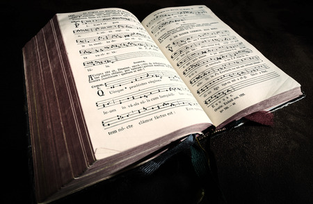 hymn: Vintage psalm book with chorus singing notes closeup Stock Photo