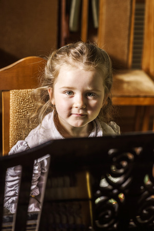 grand kid: Cute little girl playing grand piano in music school, childhood concept Stock Photo