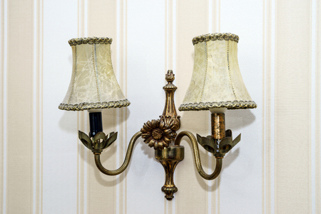 Old-fashioned wall lamp in the room, home decoration photo