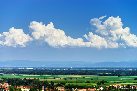 an overview: Bird-fly overview to small village in Alsace, France. Summer day.
