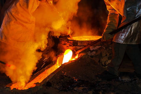 smelter: Classic technology of bell producing with melting steel in the ground. France. Stock Photo