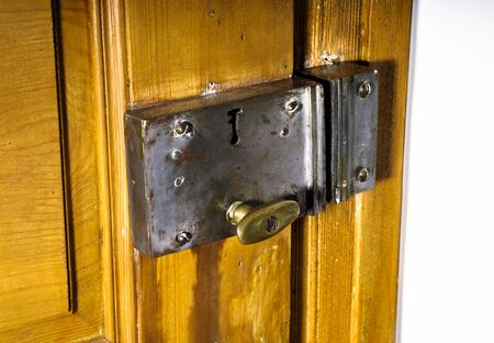 keylock: Old metal keylock on retro wooden door, vintage Stock Photo