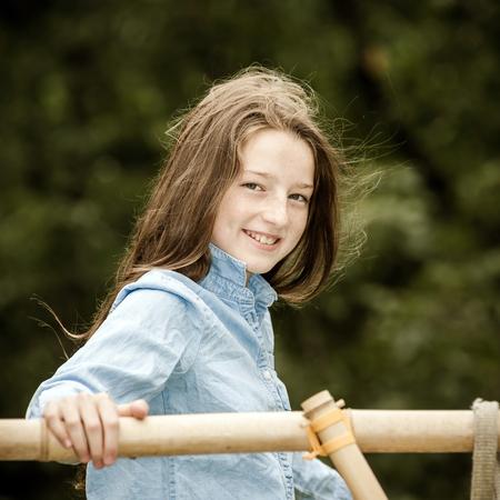 adulthood: Moving into adulthood. Outdoor portrait of teenage frekled girl.