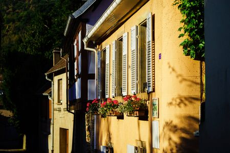 andlau: Street view of old windows with shutters, Andlau, France, Alsace Stock Photo