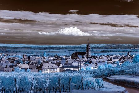 infra red: Beautiful colorful sunset over alsacien village Dambach-la-Ville. Panoramic view. France