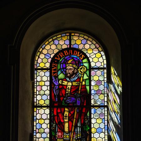 andlau: Sun lighting through the medieval leaded pane in old Saint Paul and Peter abbey-church, Andlau, France