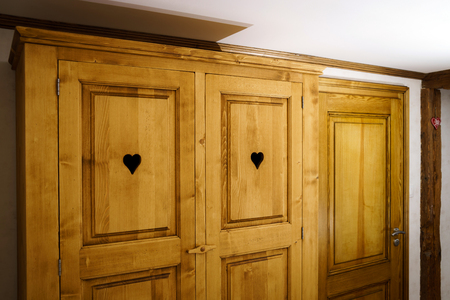 coziness: Classical  wooden wardrobe in renovated old-style apartment, french style