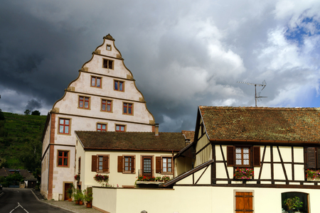 andlau: Old castle house in Andlau, Alsace, France, stormy weather Editorial
