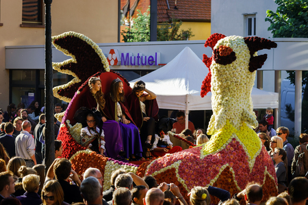 flowered: Editorial, 4 October 2015: Barr, France: Fete des Vendanges. Fancy-dress holiday and festival with orchestras and flowered carts