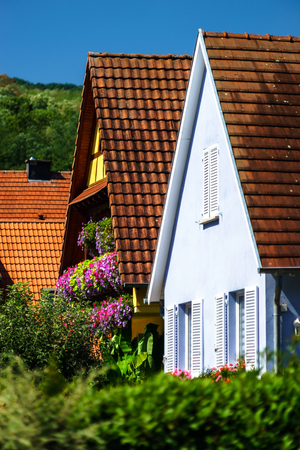 tranquillity: Classic french village house renovated and decorated by flowers, Alsace, France Stock Photo