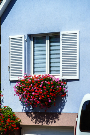 renovated: Classic french village house renovated and decorated by flowers, Alsace, France Stock Photo