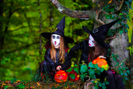 woodland  horror: Two witches in the forest, Halloween concept, childhood