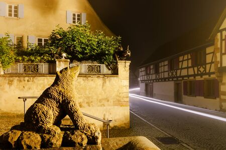 tranquillity: Night street view with fog over the village, Andlau