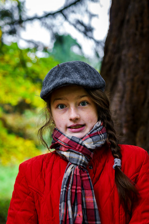 jupe: Cute teenage girl autumnal portrait in the park