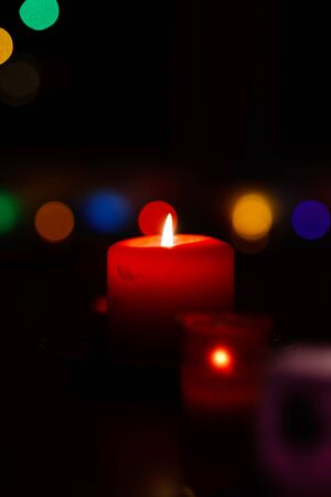 mistery: Birning candle on bokeh new year background, christmas card