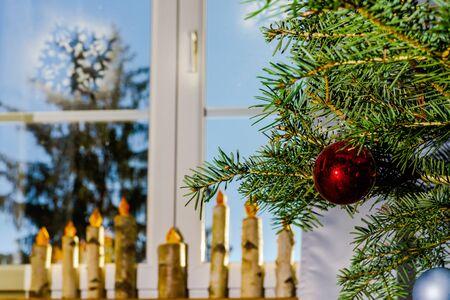 cosiness: Handmade birch candles as window Christmas decor