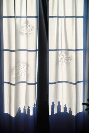 drapes: Shadows of christmas window decoration on the drapes, morning light