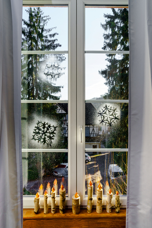 christmas decor: Handmade birch candles as window Christmas decor