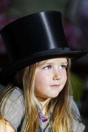 barrel tile: Cute little girl in black top hat, closeup portrait