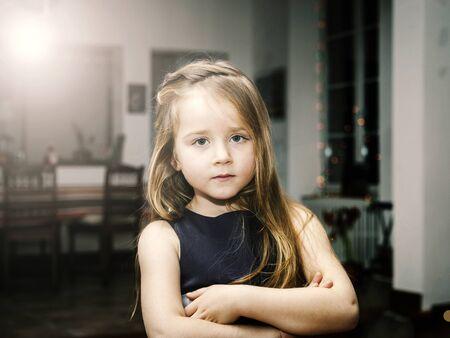 little girl posing: Cute little girl posing indoor, serious portrait