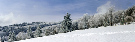 snowcovered: Snow-covered hills wide panoramic view, space and freedom Stock Photo