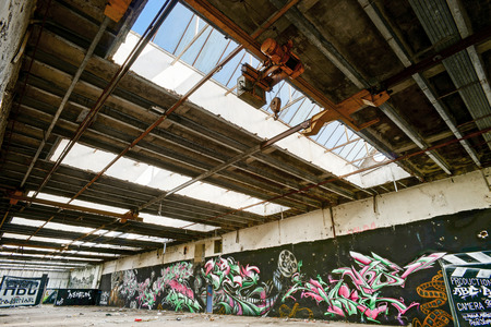 graffity: Old abandoned plant with graffity on walls, destroyed ruins Editorial
