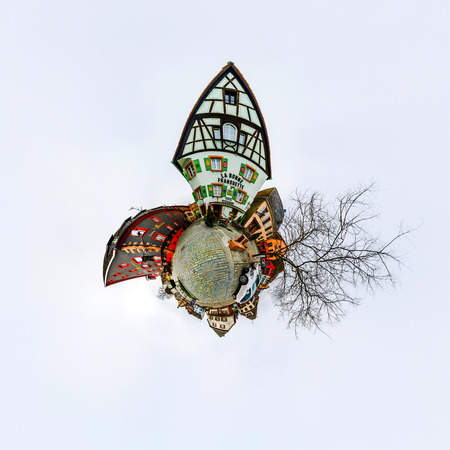 curvature: Funny street view of little french village. Curvature of space, little planet effect, panoramic view. Editorial