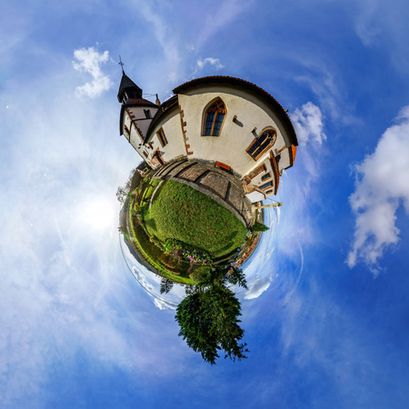 curvature: Funny street view of little french village. Curvature of space, little planet effect, panoramic view. Stock Photo