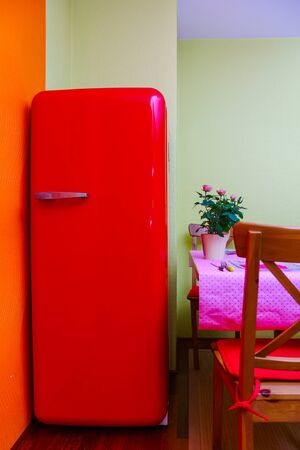 refrigerator kitchen: Retro-styled red refrigerator in the kitchen room, vintage style