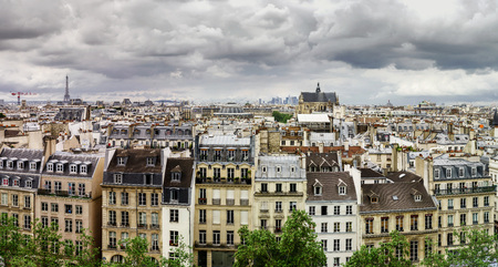 Paris roofs panoramic overview at summer day, France, traditional postcard picture Standard-Bild