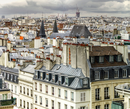 Paris roofs panoramic overview at summer day, France, traditional postcard picture Stock Photo